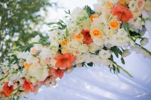 Wedding reception centerpiece close-up with pastel orange and white
